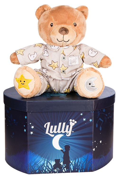 Lully the musical teddy bear sitting on the Lully box